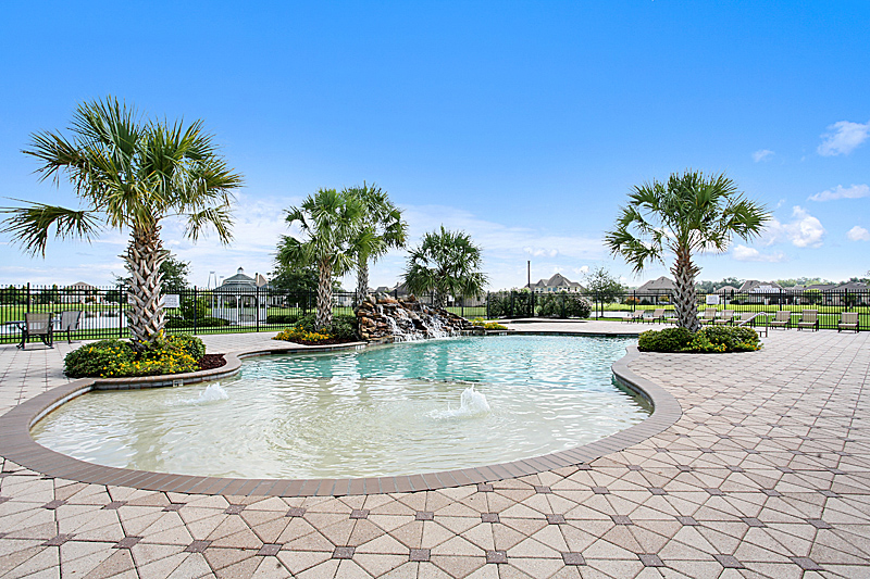The swimming pool has a beautiful, relaxing water feature.